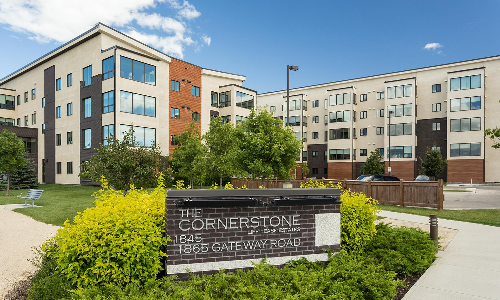 Cornerstone Life Lease Estates. Location plaque in foreground; the two Cornerstone buildings in the background.