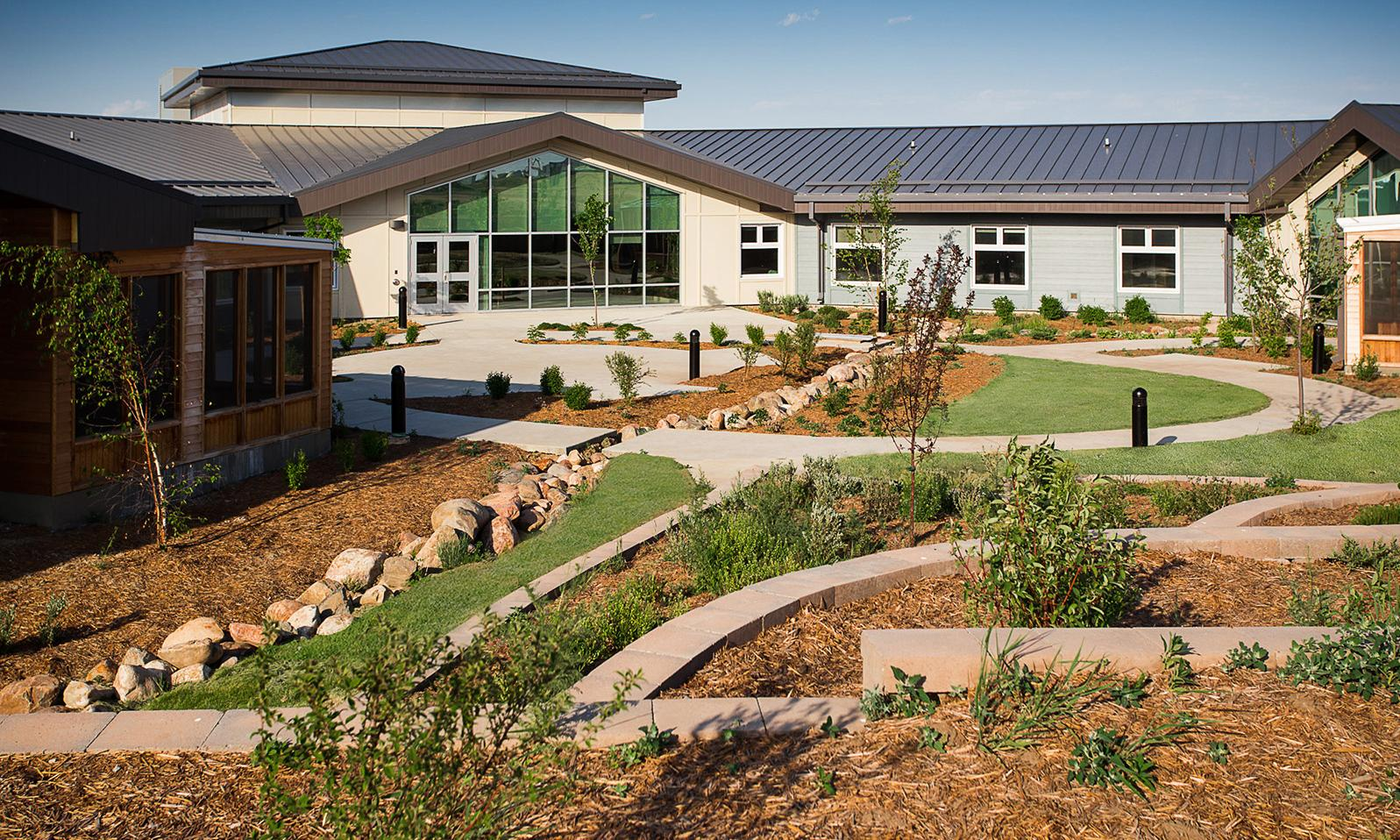 Kerrobert Integrated Health Centre. Backyard of facility with tiered lawn and gardens.